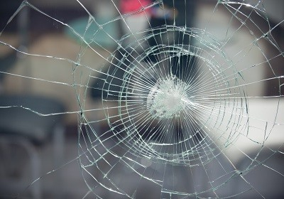 cracked window protected by safety and security window film