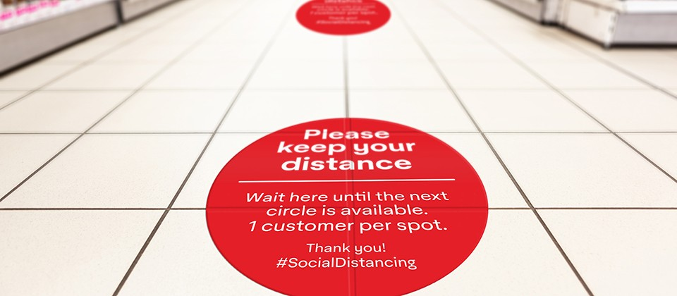 Social Distancing floor signage at a supermarket